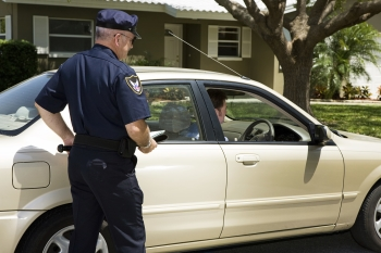 Man Pulled Over For Speeding Ticket with Police Officer By Car